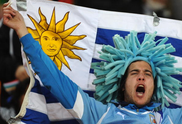 A Uruguay supporter waves his national c