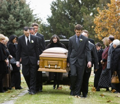 104302939-people-at-a-funeral-gettyimages