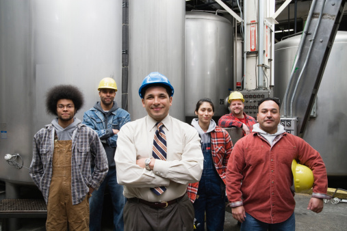 56901760-supervisor-and-his-factory-crew-gettyimages