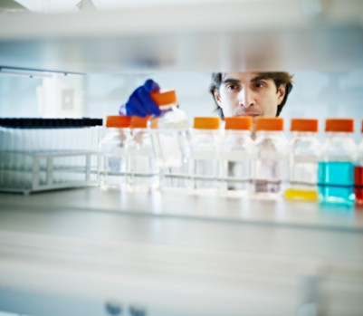 162501764-scientist-selecting-bottle-of-solution-in-gettyimages