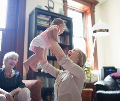 465892299-mother-lifting-daughter-with-grandmother-gettyimages