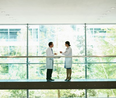 146426358-two-doctors-having-an-informal-meeting-gettyimages