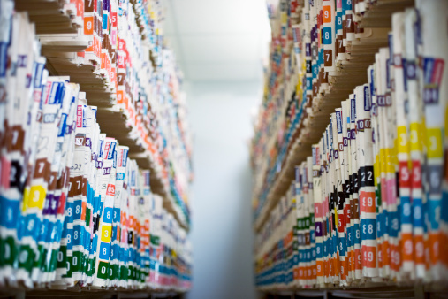 83405446-medical-records-on-shelf-gettyimages