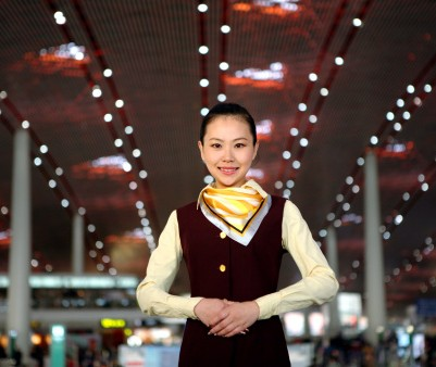 141475376-airline-stewardess-in-airport-gettyimages