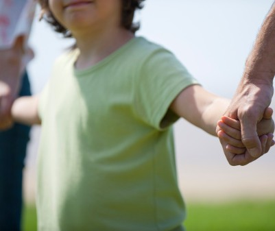 153348398-boy-holding-hands-with-parents-cropped-gettyimages