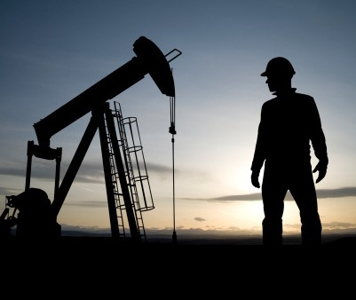 157585834-oil-worker-and-pumpjack-gettyimages