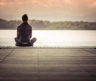 458036097-girl-sitting-alone-on-pier-in-front-of-the-gettyimages
