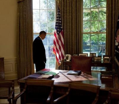 President Barack Obama Works In Oval Office