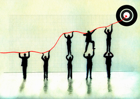 166836044-business-people-lifting-arrow-graph-to-bulls-gettyimages