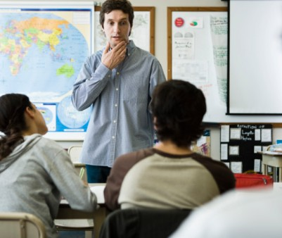 98477718-teacher-listening-to-students-question-gettyimages
