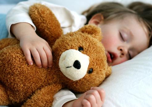 169342500-boy-sleeping-with-teddy-bear-gettyimages