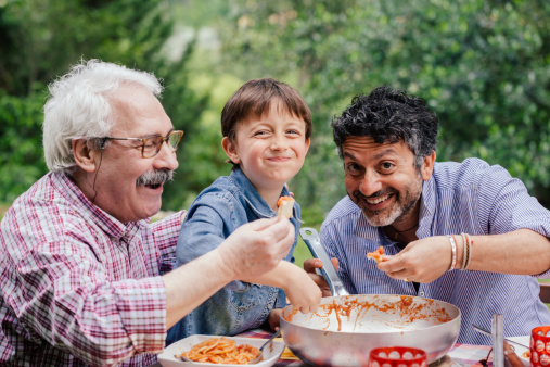 475147285-boy-enjoying-a-meal-together-with-father-and-gettyimages