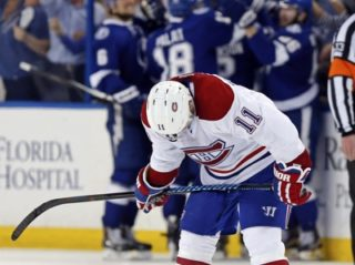 TAMPA, FL - MAY 6: Brendan Gallagher #11 of the Montreal Canadiens reacts as members of the Tampa Bay Lightning celebrate a goal in Game Three of the Eastern Conference Semifinals during the 2015 NHL Stanley Cup Playoffs at Amalie Arena on May 6, 2015 in Tampa, Florida. (Photo by Mike Carlson/Getty Images)