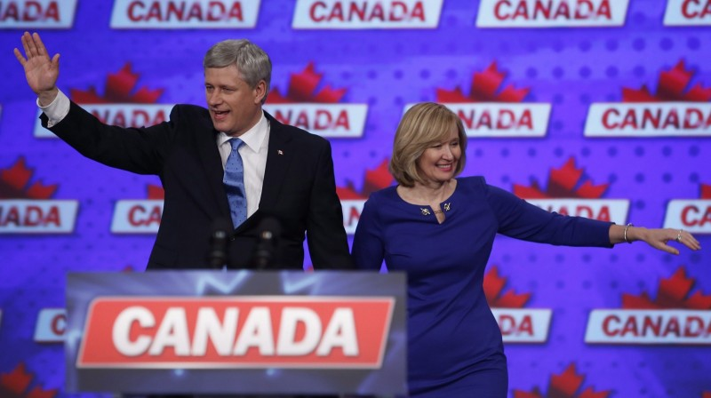 Conservative leader Stephen Harper along with his wife Laureen wave to supporters in Monday, Oct. 19, 2015 in Calgary. THE CANADIAN PRESS/Jeff McIntosh