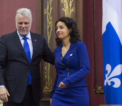 Quebec Premier Philippe Couillard, left, welcomes newly-sworn-in Economy, Science and Innovation Minister Dominique Anglade during a ceremony Thursday, January 28, 2016 at the legislature in Quebec City. THE CANADIAN PRESS/Jacques Boissinot