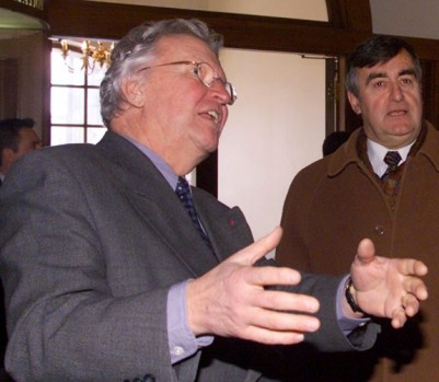 Quebec City mayor Jean-Paul L'allier, left, chats with Quebec Premier Lucien Bouchard, Thursday Mar.16, 2000,  as they enter city hall in Quebec City. Bouchard was attending a news conference on the preparations of the 400th anniversary celebrations of Quebec City. (CP PHOTO/Jacques Boissinot)