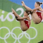Canada's Meaghan Benfeito (left) and Roseline Filion perform a dive on their way to a bronze medal win in women's synchronized 10-meter platform diving at the 2016 Summer Olympics in Rio de Janeiro, Brazil, Tuesday, Aug. 9, 2016 THE CANADIAN PRESS/Frank Gunn