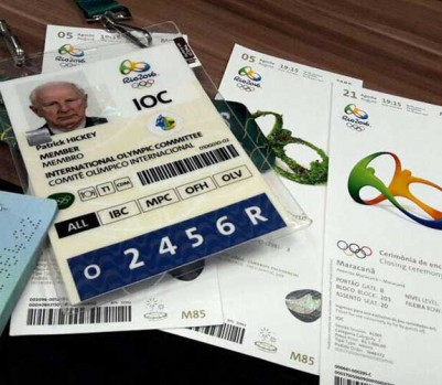 Documents belonging to Ireland's Patrick Hickey, a member of the International Olympic Committee's executive board, that include his Olympics' credential and passport are displayed alongside Olympic tickets during a police press conference in Rio de Janeiro, Brazil Wednesday, Aug. 17, 2016. Hickey was taken to a hospital Wednesday after police came to his hotel to arrest him as part of a probe into ticket scalping. Hickey, a member of the International Olympic Committee's executive board, is accused of plotting with at least six others to illegally sell tickets for the Rio de Janeiro Olympics, police said. (AP Photo/Renato Domingues)