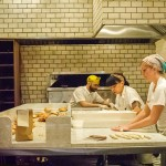 E00P7F Workers prepare artisanal Montreal style bagels in the Black Seed bagelry in Nolita in New York (Photo: Frances Roberts/Alamy Stock Photo)