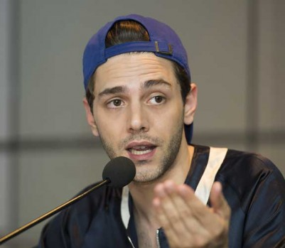Filmmaker Xavier Dolan speaks to reporters following his return from the Cannes film festival at Montreal's Trudeau Airport, Monday, May 23, 2016. THE CANADIAN PRESS IMAGES/Graham Hughes