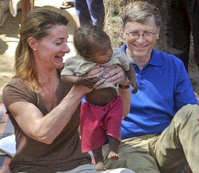 """FILE - In this Wednesday, March 23, 2011 file photo, Microsoft Corp. founder and philanthropist Bill Gates, right, and his wife Melinda Gates attend to a child as they meet with members of the Mushar community at Jamsot Village near Patna, India. The Gateses won the Lasker public service award """"for leading a historic transformation in the way we view the globe's most pressing health concerns and improving the lives of millions of the world's most vulnerable,"""" the Lasker foundation said Monday, Sept. 9, 2013. (AP Photo/Aftab Alam Siddiqui, File)"""
