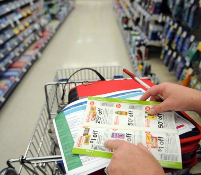 CALIFORNIA, MD, JULY 21, 2011. Kimberly Pepper-Hoctor looks at the products on sale she circled at home in a sale pamphlet while shopping. Before going shopping, she carefully screens local newspapers, advertisement flyers, coupon pamphlets and specific websites, including the manufacturers websites of products she is interested in purchasing, for coupons. Coupons are then cut out or printed out from the internet and put into a coupon file book which she places in the shopping cart while shopping. Kimberly is a corporate PR specialist and military wife living in California, Md., near the Naval Air Station at Patuxent River. She is also a lifelong coupon-cutter whose email handle is 'thegirllovescoupons'. Lately, she has been teaching others how to coupon effectively. Driven by the economy and the extreme-couponing trend celebrated on countless Web sites and a reality show on TLC, couponing has become a thing and a widely used verb. As it becomes ever more popular, more and more women like Pepper-Hoctor (and they're almost all women) are teaching others how to save.. (Photo by ASTRID RIECKEN For The Washington Post via Getty Images)