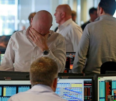 Traders from BGC, a global brokerage company in London's Canary Wharf financial centre react during trading June 24, 2016 after Britain voted to leave the European Union in the EU BREXIT referendum. (Photo : Russell Boyce/Reuters)