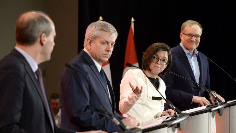Les candidats Guy Caron, Charlie Angus, Niki Ashton et Peter Julian lors du premier débat. (La Presse canadienne/Justin Tang)
